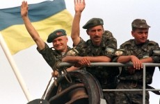 UKRAINIAN PARATROOPERS WAVE AS THEY DEPART FOR KOSOVO.