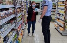 control masca covid politie femeie magazin